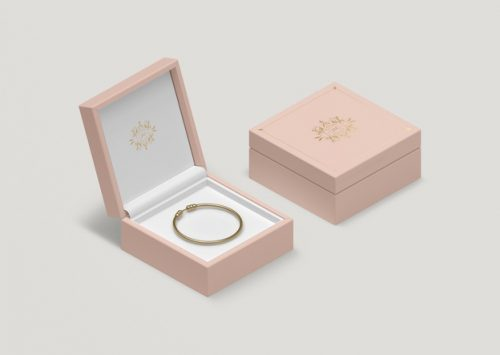 high-angle-pink-jewelry-box-with-golden-bracelet_23-2148247571